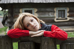 Girl. Beautiful girl is leaning on wooden fence Stock Photo