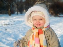 Girl. Baby with big cap during winter Stock Photos