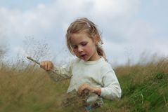 Girl. On meadow.Playing in high grass Stock Photos