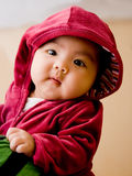 Girl. A cute girl wearing red coat Royalty Free Stock Images