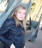 The girl. Portrait of the girl of the blond in a leather jacket in the street Stock Photo