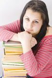 Girl. Sad young girl with many books Stock Photography