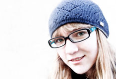 Girl. Blue eyed girl in glasses Stock Images