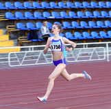 Girl on the 1500 meters race Royalty Free Stock Image