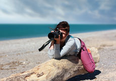 The girl. Photographer смортит in the lens view-finder Stock Image