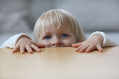 Girl. A little child and a table Stock Photography