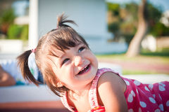 Girl. The cheerful, joyful girl with tails Stock Images