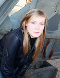 The girl. Portrait of the girl of the blond in a leather jacket in the street Royalty Free Stock Images
