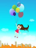 Girl. Flying on balloons over a city Royalty Free Stock Photos