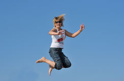Girl. On the beach. jumps Stock Image