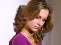 Girl. Portrait of young girl with curlings hairs Royalty Free Stock Image