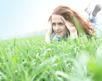 Girl. Lying on the grass Royalty Free Stock Photos