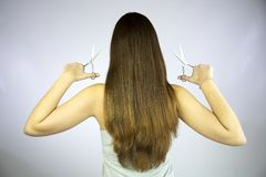 Girl with 2 pairs of scissors Royalty Free Stock Photo