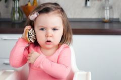 Free Girl 2 Years Old Playing With A Comb At Home - Portraying An Emotional Conversation On The Phone. Royalty Free Stock Photography - 119096287