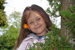 Girl. With flower in her long hair Royalty Free Stock Photo