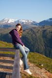 Girl. The young girl has a rest on a parapet in mountains Royalty Free Stock Photography