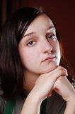 Girl. A sad brunette girl at home Stock Photo