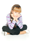 Girl. A girl sitting on the floor, isolated on white Stock Photography