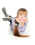 Girl. Lying on the floor and smiling, isolated on white background Stock Images