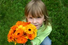 Girl. Smelling a flowers. Portret Royalty Free Stock Images