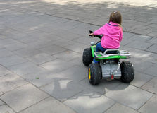 Girl. In a toy car royalty free stock images