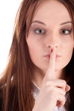 Girl. Portrate of a girl with a finger near the lips Stock Photos