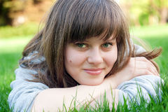 Girl. Pretty girl lying on the grass in the park Stock Image