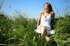 Girl. The girl sits on a glade in a grass Royalty Free Stock Photography