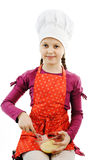 Girl. An image of a little girl stirring eggs in a bowl royalty free stock photos