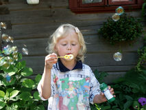Girl. Blowing a bubbles Royalty Free Stock Image