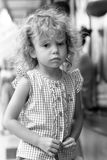 Girl 3 years with curly hair outdoors Stock Image