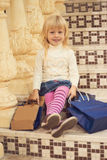 Girl 3 years old i happy sitting with shopping Stock Image