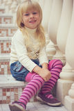 Girl 3 years old sitting on a beautiful staircase Royalty Free Stock Photos