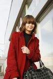 Girl_302. Portrait of a young girl in red coat royalty free stock photography