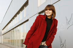 Girl_303. Portrait of a young happy girl in red coat stock photos