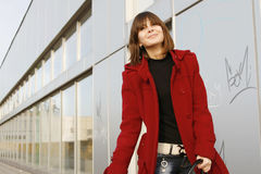 Girl_306. Portrait of a young happy girl in red coat stock photos