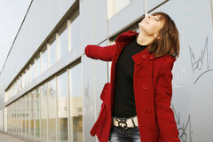 Girl_307. Portrait of a young happy girl in red coat stock photo
