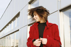 Girl_308. Portrait of a young happy girl in red coat stock photo