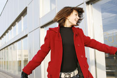 Girl_309. Portrait of a young happy girl in red coat stock photography