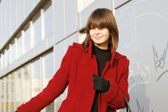 Girl_313. Portrait of a young happy girl in red coat stock photo