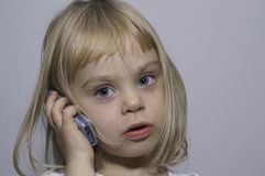 A girl. With a mobiloe phone Royalty Free Stock Image