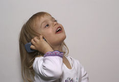 Girl. With a mobile phone Royalty Free Stock Photos