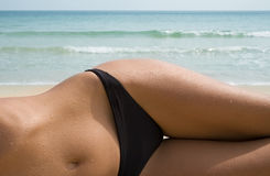 Girl. Lying on sea shore Stock Photography
