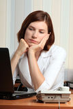 Girl. Beautiful young woman dreams at the office Royalty Free Stock Image