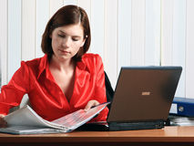 Girl. Beautiful young woman working at the office Stock Photography