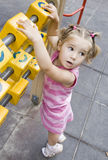 Girl. Little girl playing on playground Royalty Free Stock Image