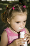 Girl. Little cute girl drinking yoghurt Royalty Free Stock Image