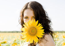Girl. Portrait of young girl with sunflower Stock Photography