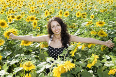 Girl. Happy girl in field of sunflowers Royalty Free Stock Image