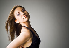 Girl. Beautiful girl in a black dress and flying hair Royalty Free Stock Photography